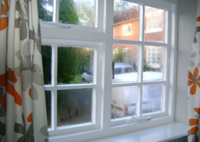 Condensation forming on an old window without Ecoease glazing